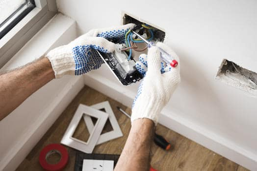Electrician S Hand Installing Power Socket Home