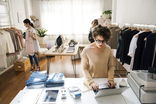 Female Business Owner Is Using Laptop