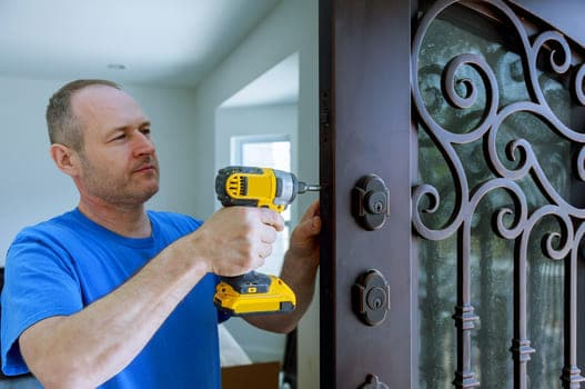 Installation Of Interior With Lock In The Door Leaf Using An Drill Screwdriver