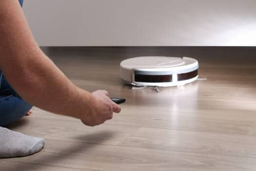 The Robot Vacuum Cleaner Cleans Under The Bed
