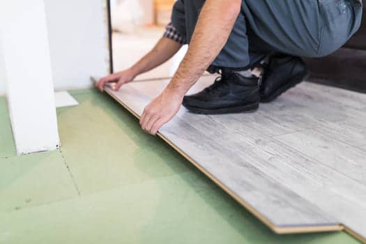 Worker Processing Floor With Laminated Flooring Boards